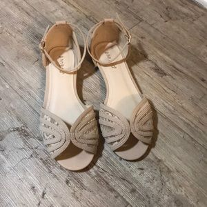 Elegant cream and lace sandals with ankle strap.